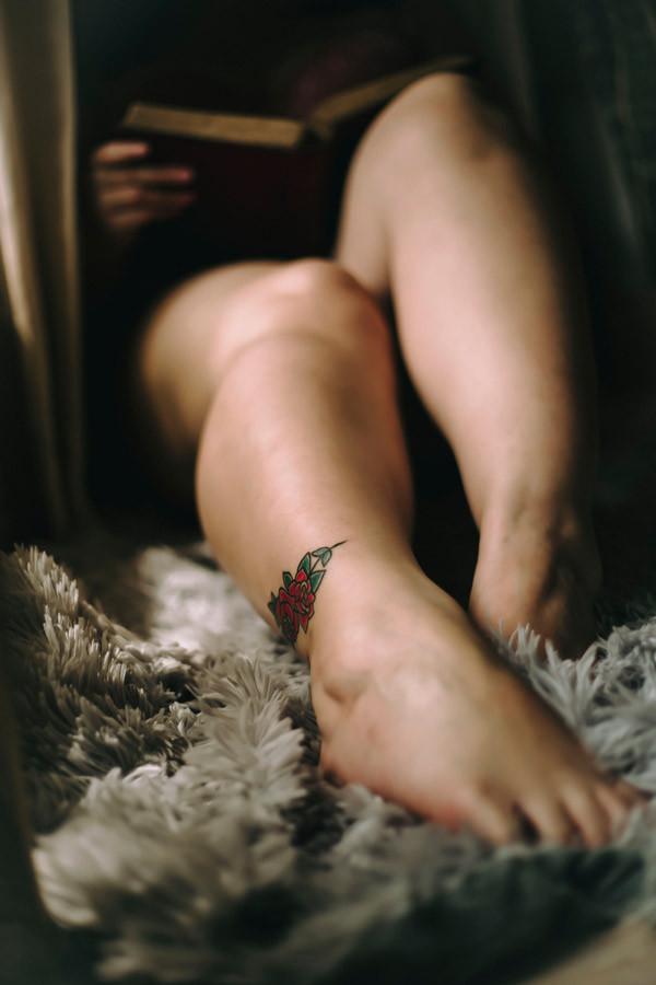 stylish rose tattoo on leg