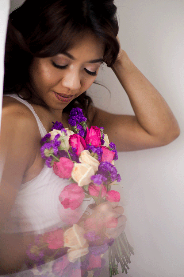 holding a bouquet of colourful flowers