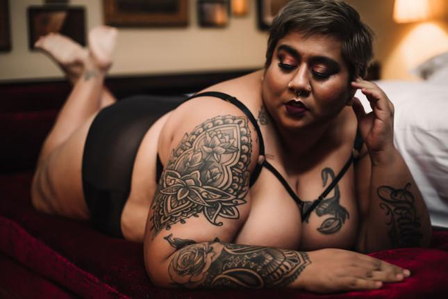 curvy woman lying on tummy.jpg