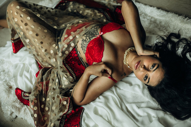 Indian woman looks glamourous in red lingerie