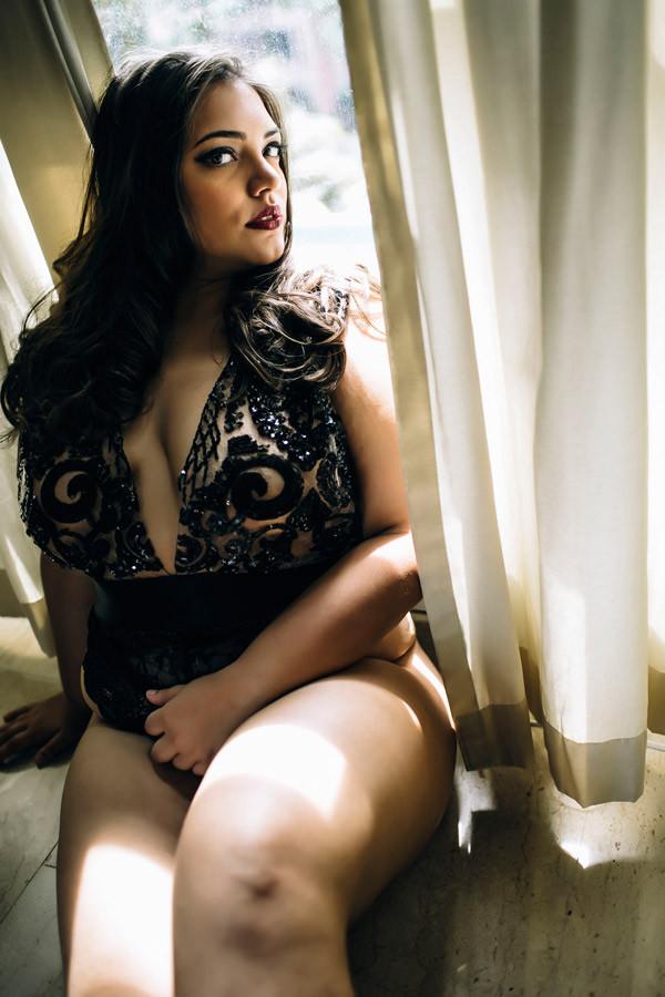 wearing a sequin lingerie near the window