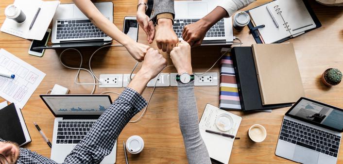 colleagues-giving-fist-bump.jpg