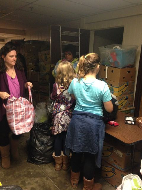 Stars Intergen Volunteers sort clothes at Gracefully Chic Boutique
