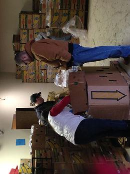 Volunteers sorting food for Helping Harvest