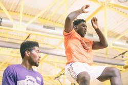 Team Cambridge's Jonathan Cenescar comes down from a dunk