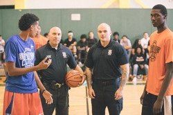Officer Sammy Mojica and Officer Keith Sweeney throw the ceremonial tip prior to the championship
