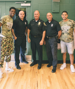 Chelsea Police Chief Brian Kyes, Officer Sammy Mojica, and Officer Keith Sweeney pose with Co-Foun