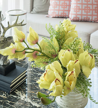 vase of flower on table in living room,