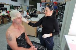 Tania applying the bald cap
