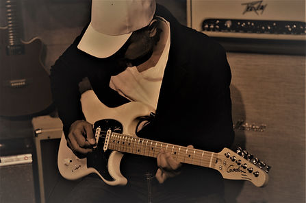 Artist JAYE (playing a Godin Progresson Plus Guitar)