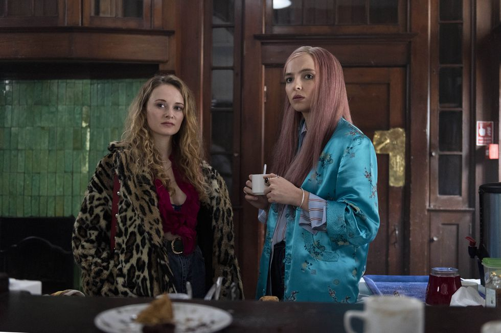 Villanelle wearing a turquoise, oriental-style, vintage jacket with a Paige striped shirt - Season 2