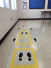 colorful tape and footprints making a sensory path