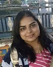 Headshot picture of Radha.
