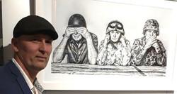 Craig Rohse with winning work, photo  'T
