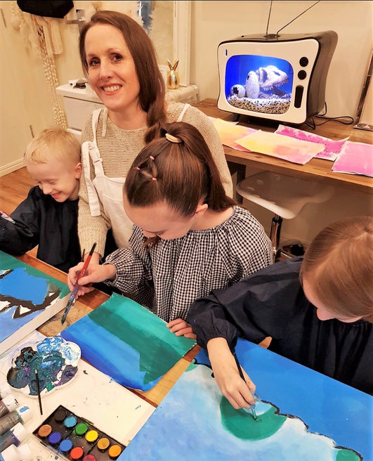 Alisa Hughes and children at art.jpeg
