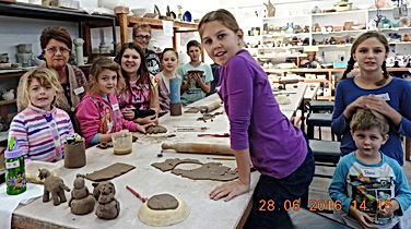 kids pottery group with Lynne.jpg