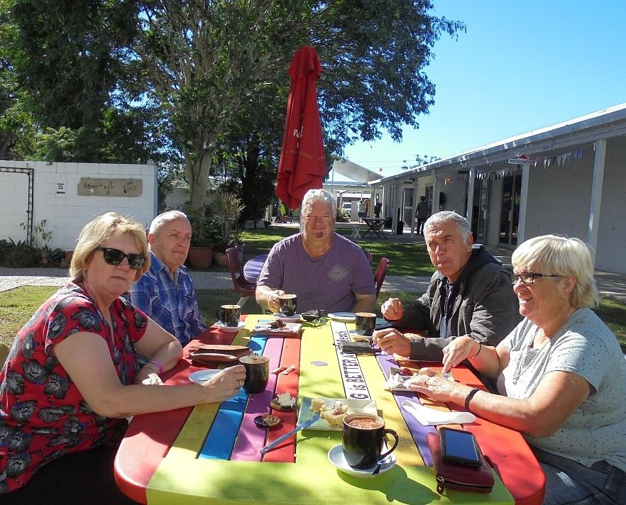 Lyn Storey's family enjoying coffee.jpg