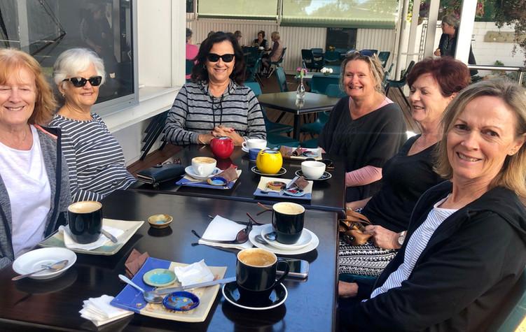 Group on Cafe deck June.jpg