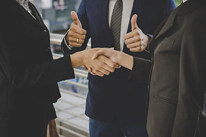 business-people-shaking-hands-finishing-
