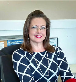 professional woman sitting at desk