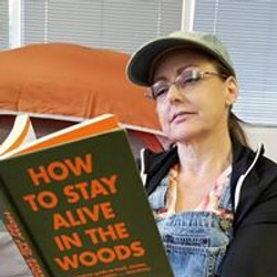 woman reading a survival guide