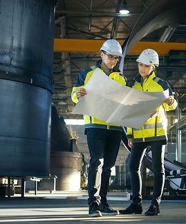 shutterstock - Engineers look at paper on site_edited.jpg