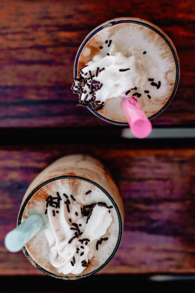 hot chocolate with whipped cream and chocolate sprinkles