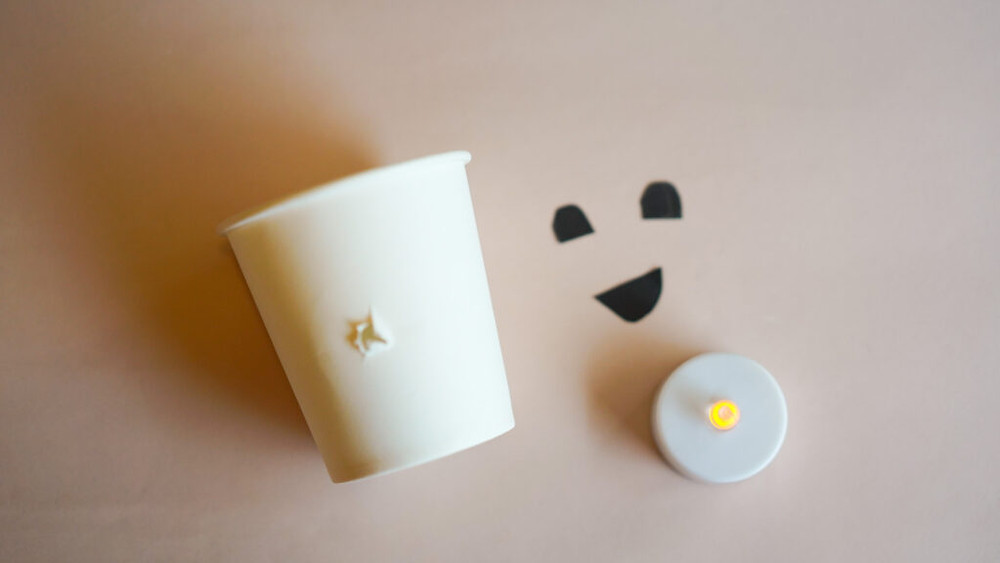 Paper cup ghosts with glowing noses