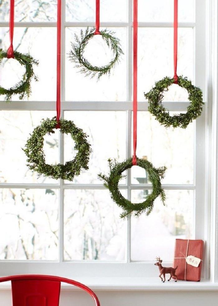 christmas wreaths on window
