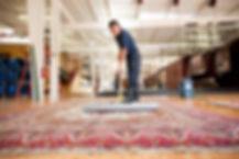 sweeping-an-area-rug-4256x2832.jpg