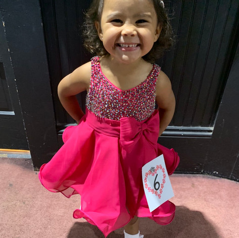 My youngest pageant sweetie.  At just 2 years old she was precious in this custom hot pink gown,  She had over 2500 handsewn tiny Swarovski rhinestones on her bodice.