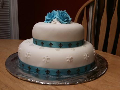 Fondant bridal shower cake with buttercream roses