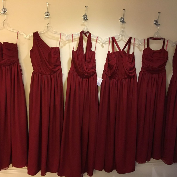 I love the presentation of when the bridal party enters the suite to get ready and their dresses are all lined up and pressed and ready to wear.