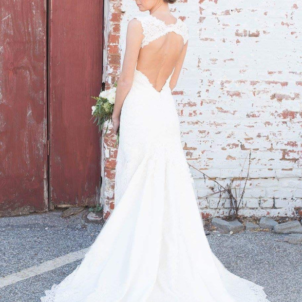 The key hole back makes a dramatic accent to this custom wedding gown.