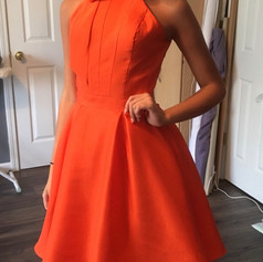 Go bold with color.  This orange silk shantung gusseted bodice was so fresh on this contestant.