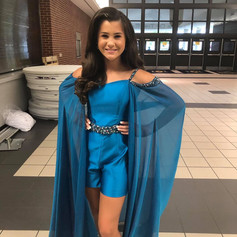 Fun fashion shows off your style and personality.  This teal satin romper with multi colored hand sewn rhinestones was the perfect compliment to the cape of teal irredescent chiffon.