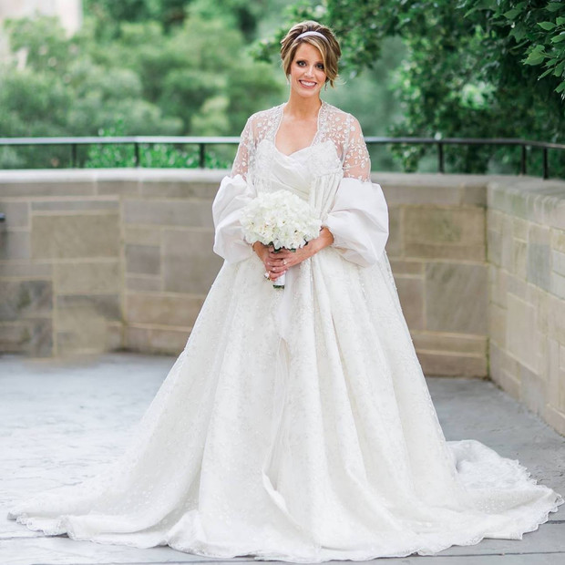 This overcoat the bride is wearing was a showstopper!  She spotted this design on a bride in Italy that took place in a castle.  I recreated the design for her in a stunning 14 foot train that trailed behind her.  The look was complete with the silk taffeta puff sleeves.