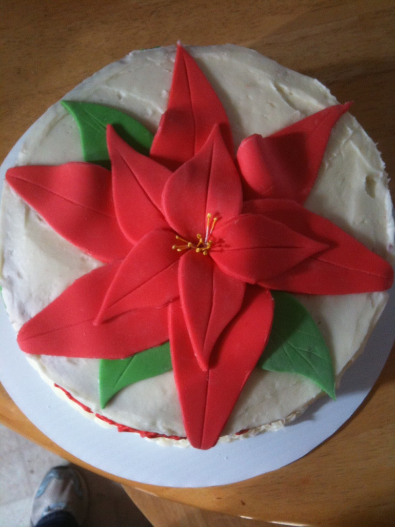Christmas party cake with fondant poinsettia