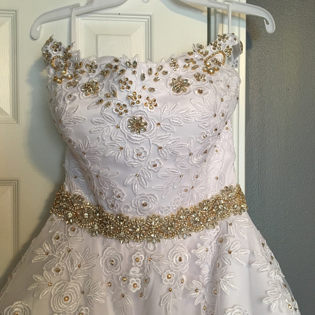 Rhinestone beading set in gold with accents of gold rhinestones