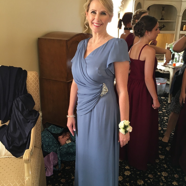Custom designed Blue silk Mother of the bride gown accented with hand beaded broach.