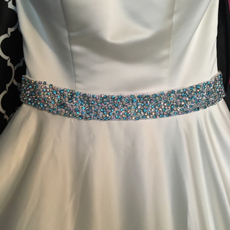 Add a little bling to your simple dress.  Several shades of Swarovski rhinestones were hand sewn for this belt.
