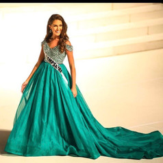 Miss New Hampshire contestant for Jr. High America was so elegant in this emerald green ball gown.  We replaced the skirt with three layers of silk organza and edged it with color matching horeshair braid for the hem.