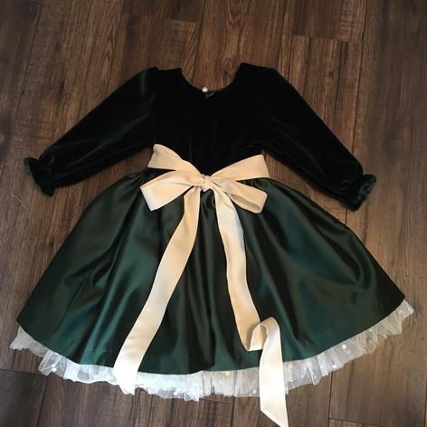 Back of green velvet and taffeta dress with ivory petticoat
