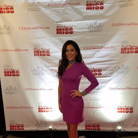 Neoprene magenta interview dress for the Miss division was stunning with gray collar and cuff details.