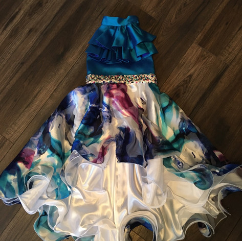 Irredescent blue silk bodice, silk floral print with fishtail hem.  Tie it together with a hand beaded belt.
