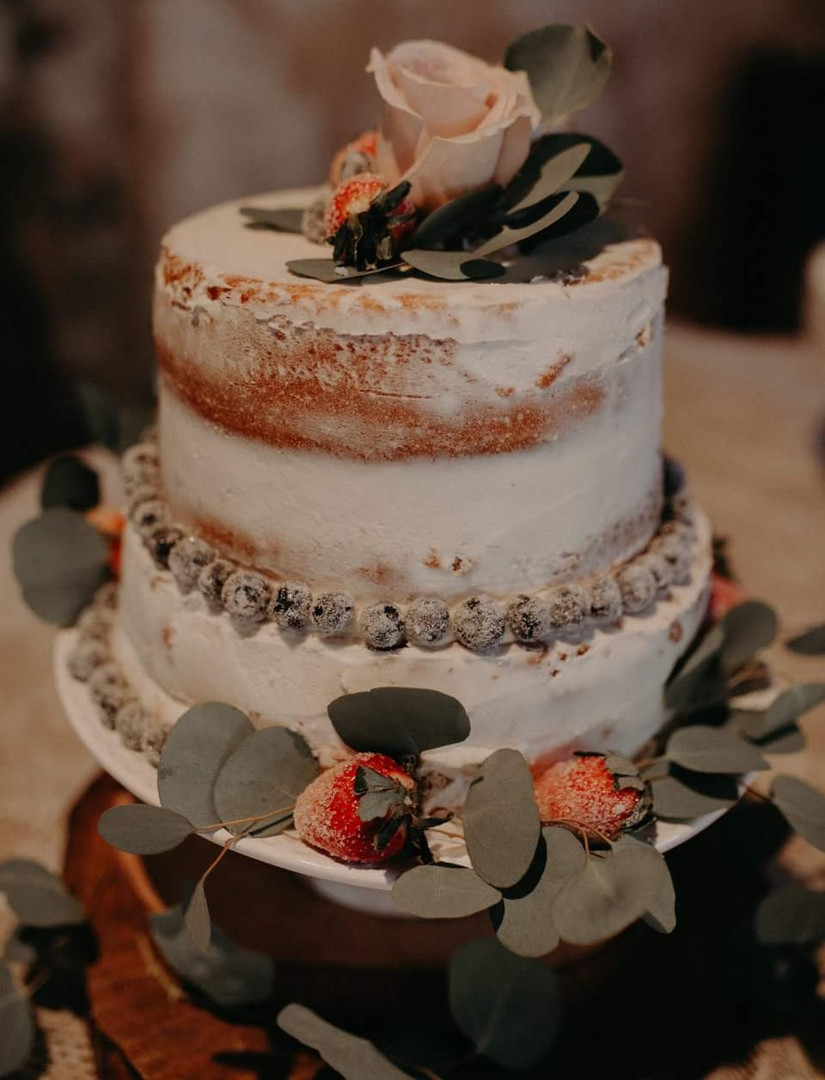 Naked wedding cake with frosted berries