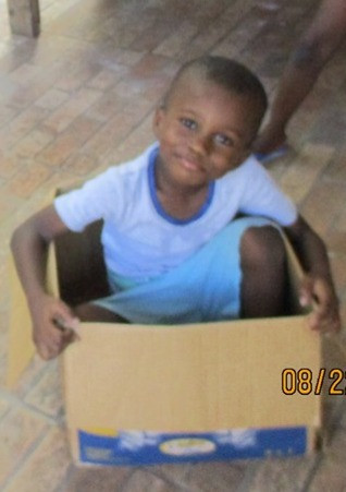 Child playing in a box