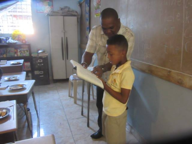 first grader reading with teacher