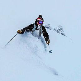Women powder skiing in Verbier