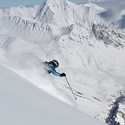 Liz Smart skiing powder in La Grave during the Steep Skiing Camp